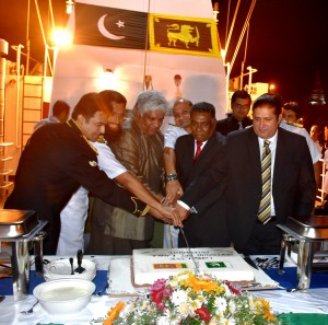 Minister for Ports & Shipping,  Acting High Commissioner of Pakistan,  Mission Commander of Pakistan ships jointly cutting the SL-Pak Friendship Cake