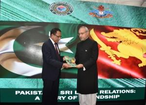 H.E. Shakeel Hussain presenting the book to Hon. Kabir Hashim