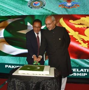 Minister for Enterprises Development Hon. Kabir Hashim and High Commissioner of Pakistan H.E. Shakeel Hussain cutting the Pakistan National Day cake