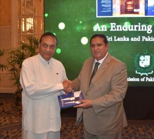 Acting High Commissioner Dr. Sarfraz Sipra presenting book to Speaker Parliament Hon. Karu Jayasooriya