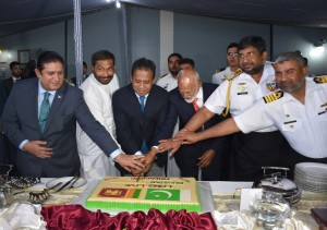 The Actign HC  cutting the cake along with Ministers and  top defense officials